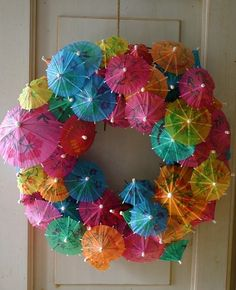 17 Hot DIY Summer Wreaths - collected by TwoPlusCute.com: Party umbrelas summer wreath