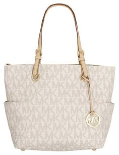 This Michael Kors Signature PVC Tote bag is a classic style that has become a staple in Michael Kors & handbags.