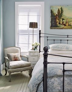 Nice bed.  Victorian Home Designer Carrie Raphael - Swedish Style Maryland Farmhouse - Country Living