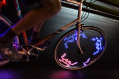 M232 Monkey Light bicycle wheel light.  Photo by Antoine Pethers Unicycle, Bicycle Wheel, Bike Accessories, Cheap Cars, Bicycle Lights, Car Wheels, Bike Life, Monkey, Pedal Cars