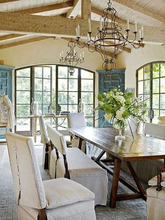 Large arched windows and doors let sunshine poor into this dining room