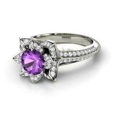 I like this one even more than my first one! Amethyst stone surround by white sapphires!