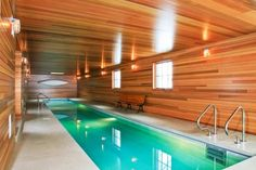 Hotels and Resorts - Wooden Farmhouse Hotel With Pool In Room Design With Long Pool And Wooden Plank Wall And Ceiling With Some Wall Lamps: ...