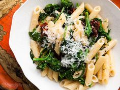 Broccoli Rabe with Pasta and Sun Dried Tomatoes ~ Broccoli rabe, blanched then sautéed in olive oil with garlic and chili pepper flakes. Tossed with sun dried tomatoes, pasta, and Parmesan. ~ SimplyRecipes.com