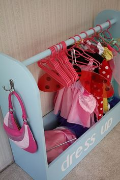 what a cute dress- up storage rack for the girls.