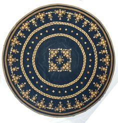 Round Blue Tablecloth with Marash Embroidery.  Cloth is 80 inch diameter royal blue velvet with double inner circle.  Thread is DMC 25.  Thread colors are yellow and mustard.  Thread has six strands; use only three of the six strands to embroider (cut the desired length of the six-strand thread, then pull three strands together and thread them into the needle).  Sizes and colors may be varied to the taste of the individual.