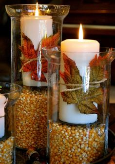 Candlelit Leaves Centerpiece: Add some major ambiance to your table decor with these candlelit fall leaf arrangements. The corn kernels give an extra boost of fall vibes and we love the way the leaves are held onto the candles with a simple twist of twine.