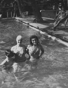 Christmas 1941: Joe Jr., Kahtleen, Jean, and Teddy Kennedy playing at the pool in Palm Beach.
