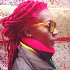 I'm really thinking of coloring one of my locs pink..hmmmm...maybe in the back..
