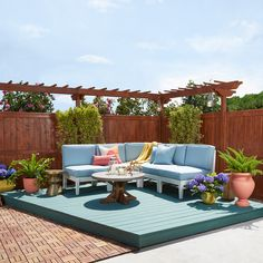 Provide contrast and depth to your outdoor space by using a different color on the fence and the deck. Deck: BEHR PREMIUM DeckOver® in Mountain Spruce SC-114. Fence: BEHR PREMIUM Semi-Transparent All-in-One Wood Stain & Sealer in Sable ST-135. Photo courtesy of Food Network.