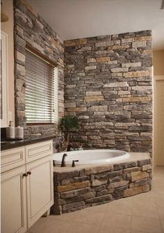 Bathroom on second floor. The bathroom ends where the stone wall is, keep the tiled floors, make the stone smoother and add a toilet and frosted glass shower to the right (out of frame) and its perfect.