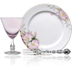 """Spring flowers tableware arrangement with """"Wistaria"""" glass pattern in pastel pink from Tiffin / Franciscan, """"Strasbourg"""" silver pattern from Gorham, & """"Azalea"""" china pattern with pale pink flowers from Noritake."""
