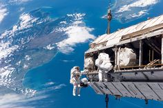 Spacewalk / Blue Bath. STS-116 Mission Specialists Robert L. Curbeam, Jr. (left) and Christer Fuglesang participate in the first of the mission's three planned sessions of extravehicular activity as construction resumes on the International Space Station. Spacewalks – Blue Sky: 2006 credit: NASA