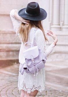 Foldover buckled backpack which has pockets at the front and sides with snap buttons. This looks perfect with any of your outfits. | Lookbook Store Bags Collection