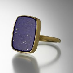 Like a starry night, this Gabriella Kiss ring will soothe your senses. Framed in 18K yellow gold, this smooth lapis slab stacks beautifully with your collection, or makes a powerful statement of beauty all on its own.<br><br>Stone measures 14.6mm x 10.9mm<br>Size 5