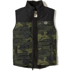 Hollister Sherpa-Lined Puffer Vest ($48) ❤ liked on Polyvore featuring men's fashion, men's clothing, men's outerwear, men's vests, camo, mens camo puffer vest, mens puffer vest, mens puffy vest, mens camo vest and mens faux fur vest
