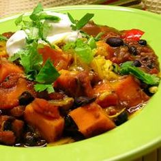 "Sweet Potato and Black Bean Chili | This hearty vegetarian chili includes roasted sweet potatoes and black beans, along with spicy, flavorful seasonings such as chili powder, jalapenos, and cocoa powder."" http://allrecipes.com/recipe/sweet-potato-and-black-bean-chili-2/detail.aspx"