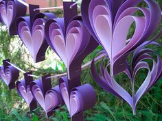 Bridal shower decoration ideas purple and silver themes with vintage wedding paper flowers two garlands purple hearts
