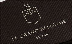 Le Grand Bellevue is a revamped luxury hotel in Gstaad. Construct's brand identity begins with a mark that reflects the owners' approach of borrowing influences from different quarters and periods. It aims to be a contemporary take on the heraldic shield that also draws inspiration from the markings on a cow bell. The designers say its geometric shapes suggest the mountains that are the backdrop to the hotel and the distinctive towers of the hotel's 1912 architecture.