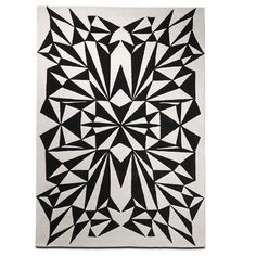 Contemporary Symmetry Rug - Place this illusional rug in your home for a pop out present of black and white. It will change the dimension of the room for an edgier look. - Found at myWebRoom.com