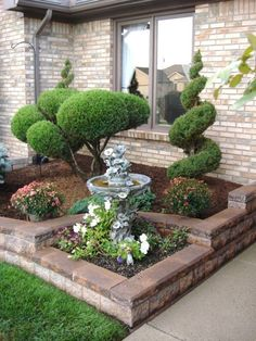 I found a picture of this really nice front yard with the spruce tree, bushes, and the fountain. Looks really nice!