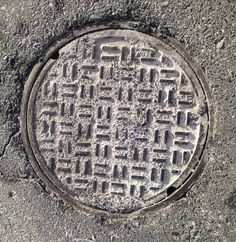 Throwing Bodily Fluid at Certain Law Enforcement Officers, N.J.S.A. 2c:12-13 - Photo:  Manhole Cover, Woodbury, NJ