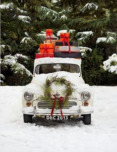 Old pick up truck complete with  wreath and Christmas packages