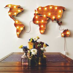 light up world map | wood i like this a lot... but they couldn't hide the cord?