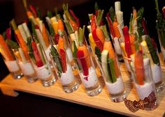 Veggie sticks in shooter glasses - classy way to do a veggie tray!