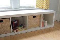 Ikea toy storage. We have this in our living room under a low window. It works great for toys!