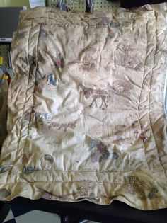Artifact - doll blanket found in attic over kitchen