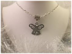 A personal favorite from my Etsy shop https://www.etsy.com/listing/207065101/christmas-angel-necklace-silver-with