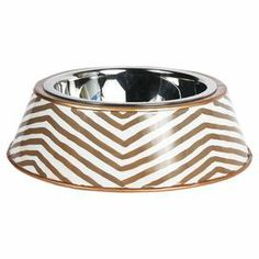 """A bold essential for your four-legged friend, this chic pet dish is crafted from recycled metal with a hand-painted chevron motif.   Product: Pet dishConstruction Material: Recycled metal  Color: TaupeFeatures:  Hand-paintedLead-freeDimensions: Small: 4"""" H x 6.5"""" DiameterLarge: 4"""" H x 9"""" Diameter  Para mi Felipe"""