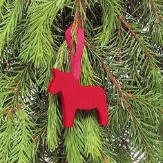 Traditional Dala Horse in festive Red. Beautiful crafted decoration made in Sweden to creat that gorgeous Scandinavian christmas feel. For all those horse lovers too!