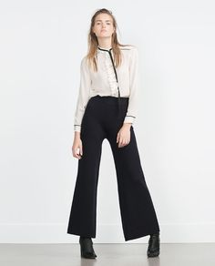 Image 1 of BLOUSE WITH TIE NECK from Zara