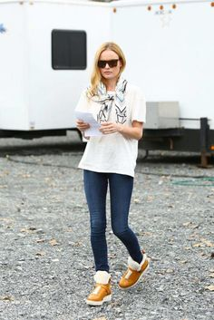 Kate Bosowrth puts a fun spin on her 3x1 jeans and t-shirt look adding a printed scarf and shearling Coach boots.