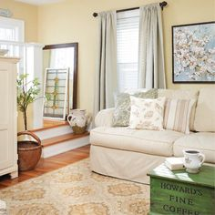 a pretty room with ideas of how to incorporate pattern. i really like the coffee table.