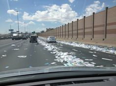 Las Vegas highway strewn with paper after box falls from truck