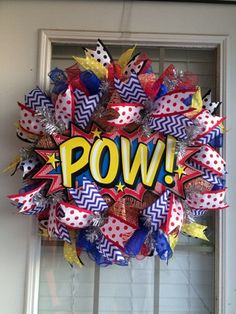 For the Super Hero Fan in all of us. This bright, colorful wreath just screams fun and power, from its central sign to the bursts of spiral colors. Perfect for any comic book fan, and the primary colors lend themselves perfectly to a babys room. Superhero School Theme, Baby Superhero, Superhero Room, School Themes, School Ideas, New Classroom, Classroom Themes, Library Themes, Beginning Of The School Year