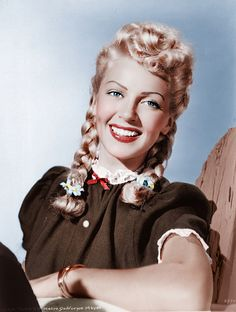 Lana Turner ...... Not typical Lana but all innocence and curls. What a beautiful young woman!
