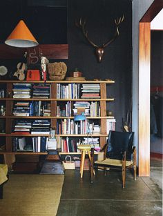 Love the color palette in this room... the books and accessories add so much. via Lonny's blog 10.20.11