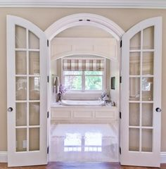White arched interior doors with glass