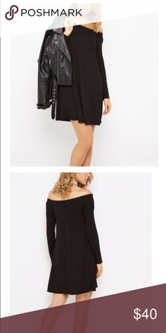 black off the shoulder swing dress A good look for any day of the week, this casual swing dress is crafted with soft jersey knit. It's fashioned with a flirty off-shoulder build and is perfect for styling with your favorite accessories.  95% rayon, 5% spandex Machine wash Dresses Midi