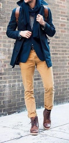 Men's Dark Brown Leather Boots, Khaki Chinos, Navy Trenchcoat, Navy Blazer, Dark Brown Leather Belt, White and Black Vertical Striped Longsleeve Shirt, Navy Scarf, and Brown Leather Backpack