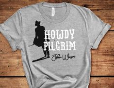 Plus Size T-Shirt, John Wayne T-Shirt, Howdy Pilgrim Tee. Americas Cowboy T-Shirt,  The Duke Movie Quotes, Western Movie T-Shirt, by ButlerTees on Etsy John Wayne, Flower Girl Shirts, Plus Size T Shirts, Movie T Shirts, American Actors, Movie Quotes, Shirts For Girls, What To Wear, Xmas