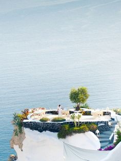 Private resort on Santorini, Greece tropical island for a beach vacation. An ideal location for wedding and honeymoon lp