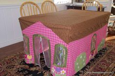 "table cloth fort table ""I thought something like this would be fun for the girls. When I say 'like this,' I imagined I might sew five rectangles together and cut a hole for the door. Luckily, I asked grandma if she'd want to make one. This was her creation... The pattern is McCall's pattern M6369."