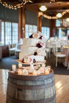 Elegant wedding cake idea - buttercream frosted cake with blush + burgundy flowers and last name cake topper {Kari Dawson Weddings}