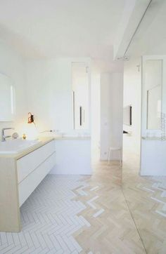 Integrated flooring - herringbone tiles and wood, from wet zone to the rear of the bathroom