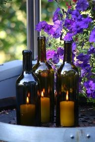 wine bottle candles - look for DIY glass cutting info. Great for wine themed event ambiance. Wine Bottle Candle Holder, Diy Candle Holders, Wine Bottle Crafts, Diy Candles, Bottle Art, Pillar Candles, Candle Lanterns, Candle Jars, Prices Candles